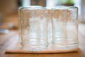 Jam making, rinsed jars draining