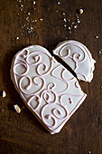 A broken, heart-shaped biscuit with icing