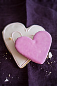 Two heart-shaped biscuits with icing