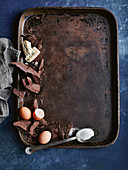 Ingredients for flourless chocolate cake with blue cheese on a baking tray