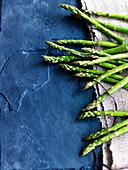 Green asparagus on a slate plate