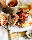 Burgers with bacon, baked beans and coleslaw
