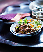 Beef Madras with carrots, cucumbers and coriander leaves (India)