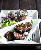 Beef burgers with gherkins and salsa