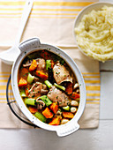 Chicken stew with celery, carrots, leeks, mushrooms and mashed potato
