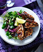 Grilled chicken wings with ginger, lime and salad