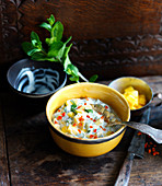 A bowl of mango raita with chilli and mint (India)