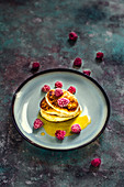 Pancakes with frozen raspberries