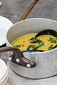 Red lentil soup with beetroot leaves