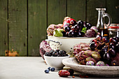 Fresh organic fruits and vegetables, grains, legumes and nuts on concrete background