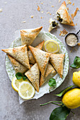 Spanakopita triangles or spinach pie is a Greek savoury pastry