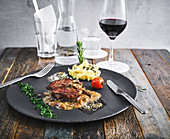 Horizontal shot of a steak with mushroom ragout and polenta