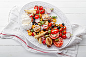 Fresh and zesty salad with tomatoes and mozzarella cheese served on a platter with spices