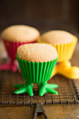 Lemon muffins in colourful plastic cases with legs