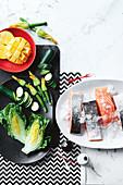 Salmon, mango, zucchini, zucchini flowers and romaine lettuce