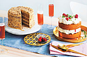 A layer cake with nuts and and an Eton Mess cake with lemon and raspberries