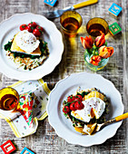 Roasted smoked fish with poached eggs and tomatoes