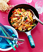 Sweet and sour chicken with noodles and vegetables (Asia)