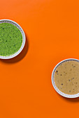 Coriander and peanut pesto and spicy peanut sauce