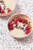 Warm chia and yoghurt pudding with granola and pears