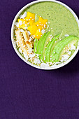 A matcha smoothie bowl with avocado and roasted bananas