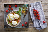 Burrata with olive oil, tomatoes and basil