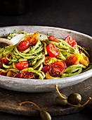 Linguine pasta with pesto sauce and tomatoes