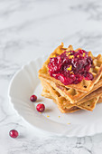 Stack of waffles with cranberry jam