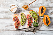 Healthy breakfast bread with avocado and figs, coffee and honey