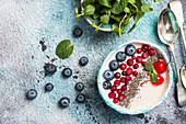 Light greek yogurt dessert with chia seeds, goji and fresh berry served