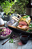 Mustard-crusted veal roast with red cabbage slaw