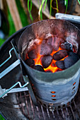 Glowing coals in a chimney starter