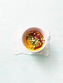 Chickpea salad with pomegranate seeds on carrot cream
