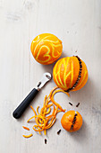 Making orange pomanders using zester and cloves