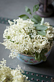 Freshly cut elderflowers in a bowl