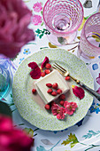 Almond pudding with fruits of the forest and rose petals