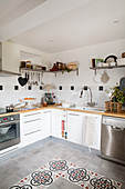 Patterned floor tiles in modern country-house kitchen