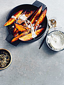 Roasted sweet potatoes with chilli and seeds