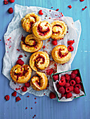 Raspberry, Polenta and Pink Peppercorn Scrolls