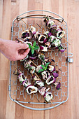 Grilled calamaretti skewers with shiitake and garlic
