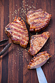 Grilled pork chops with a juniper berry and honey glaze