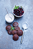Grilled chocolate blinis with cherries with vanilla cream