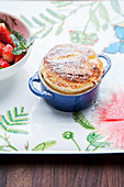 Grilled quark soufflé with strawberries and macadamia nuts
