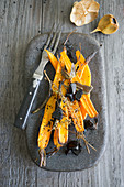 Baked carrots with black garlic, thyme and sage