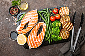 Grilled salmon steak, chicken and vegetables