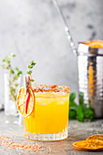 Refreshing summer citrus cocktail with orange, lemon juice and ice