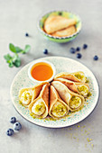 Atayef, small pancakes with semolina cream and orange syrup (Arabia)