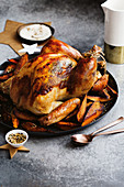 A whole roast turkey with truffle salt and sweet potatoes