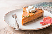 Slice of Festive Homemade Pumpkin Pie with Whipped Cream