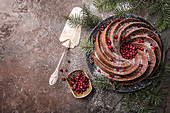 Gingerbread Bundt Cake for Christmas with lingonberry and christmas decorations